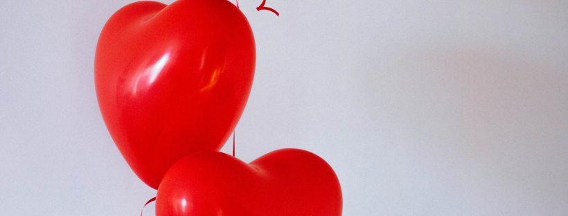 Three red heart-shaped balloons