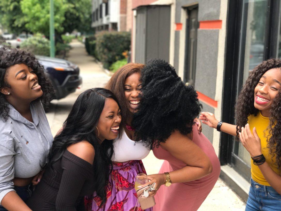 5 women laughing