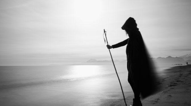 person standing near a calm sea